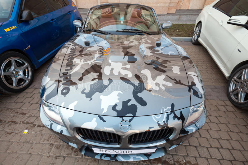 BMW z4 roadster car with gray camouflage color. Saint-Petersburg, Russia - April 11, 2015: BMW z4 roadster car with camouflage color scheme stands parket on the royalty free stock photo