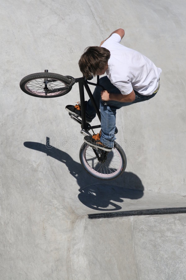 BMX'er launching off the lip stock image