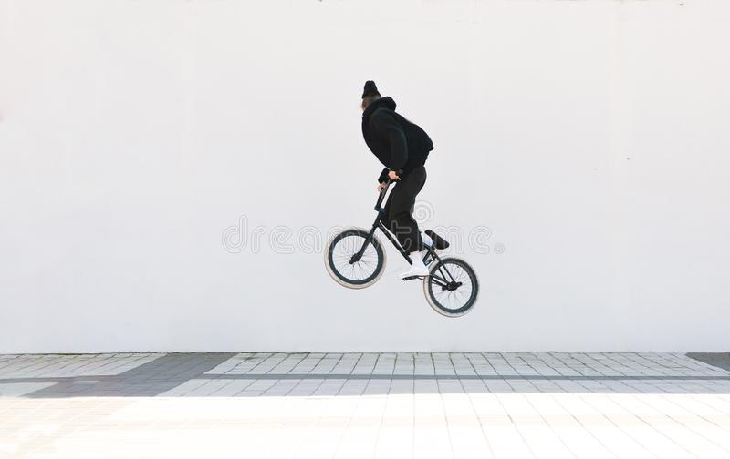 Bmx freestyle on the background of a white wall royalty free stock photography
