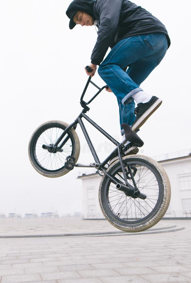 Free BMX Freestyle Close Up. Young Man Makes Stunts On A BMX Bike.Street Culture Stock Images - 140968324