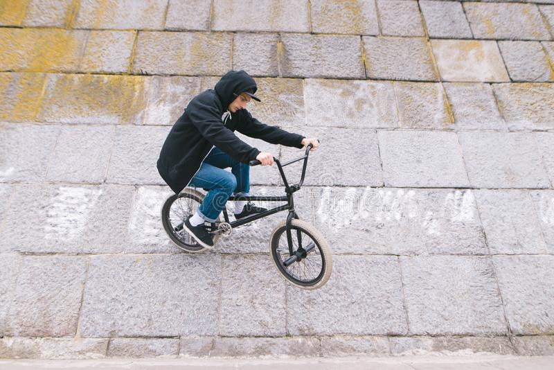 Bmx Freestyle. man rides a wall on a bmch bike. Tricks on the wall royalty free stock photos