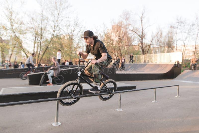 Bmx rider performs a trick on a skate park. Training on bmx. Bmx concept. Slip on stock image