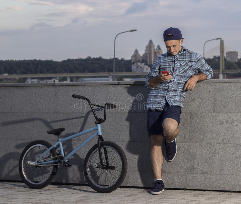 Bmx rider taking a pause during a training session stock photo