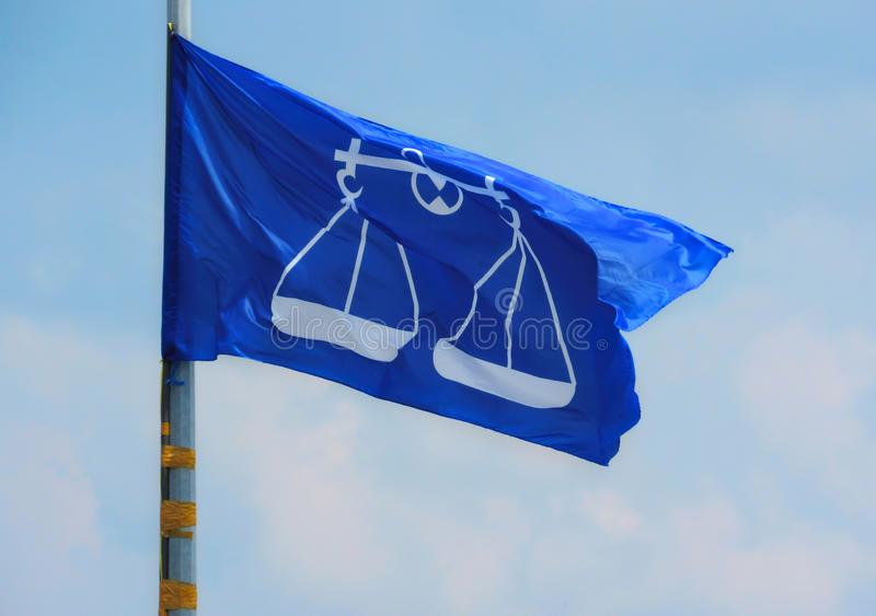 BN Flag Flying In The Wind. The flag from the Malaysian coalition political party, Barisan Nasional BN mounted to a lamp post and flying in the wind stock image