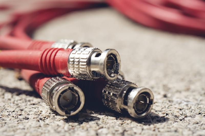 CCTV cable RG6 RGB TV coaxial type to recording device red color tone. BNC Connectors Coaxial Red Cables Closeup. CCTV cable RG6 RGB TV coaxial type to recording royalty free stock photo