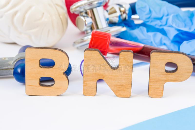 BNP abbreviation or acronym in foreground in laboratory scientific or medical practice meaning brain natriuretic peptide, with mod royalty free stock image