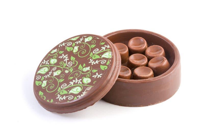 Boîte à chocolat avec des bonbons de chocolat image libre de droits