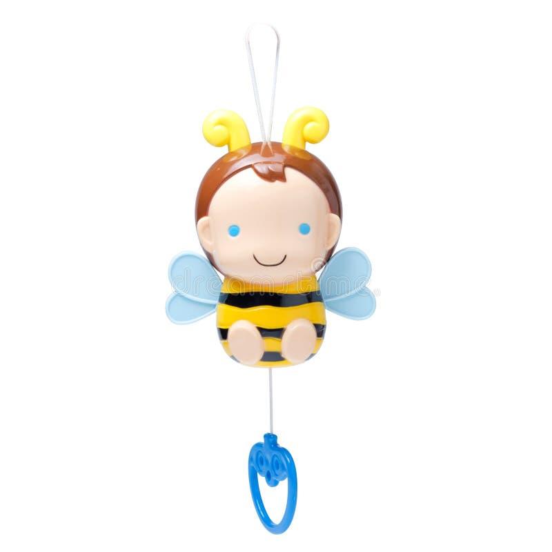 Boîte à musique de jouet d'abeille pour l'enfant d'isolement sur le fond blanc images stock