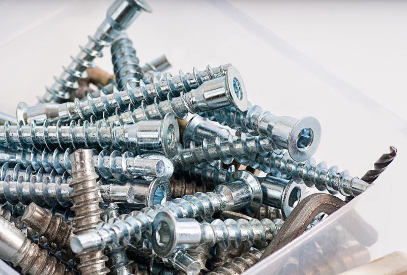 Boîte à outils, cadre pour le boulon en métal, noix, vis, clou photos stock