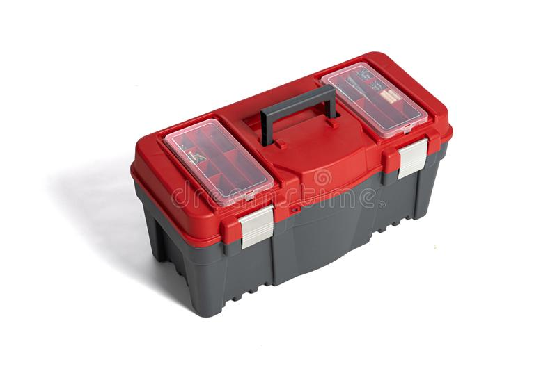 Boîte à outils en plastique sur un fond blanc Ensemble d'outils de travail Th?me de DIY photographie stock