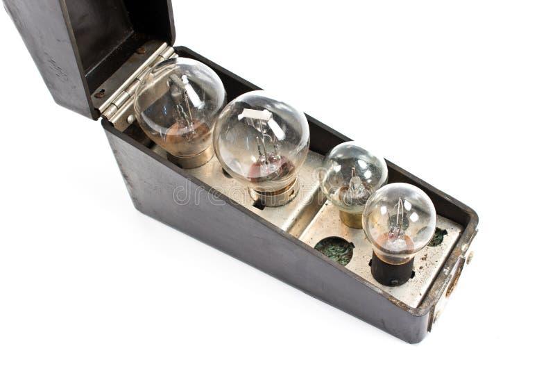 Boîte avec l'ensemble de vieilles ampoules image libre de droits