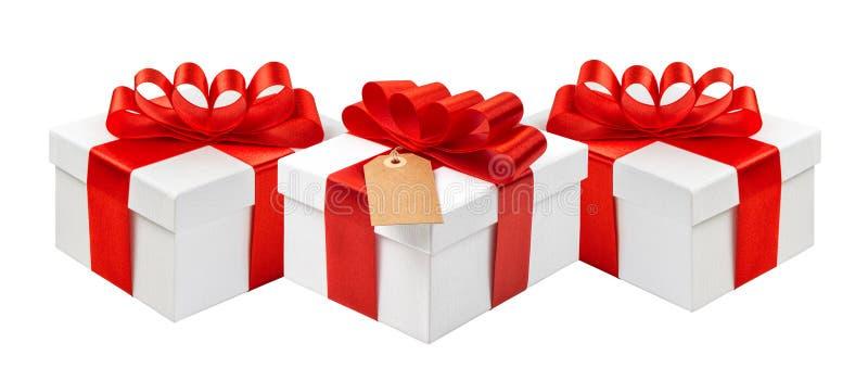Boîte-cadeau avec la décoration rouge d'arc de ruban Certifica de carte de vacances photos libres de droits