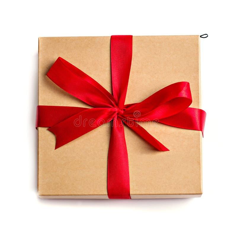 Boîte de papier d'emballage de cadeau avec un arc photographie stock libre de droits