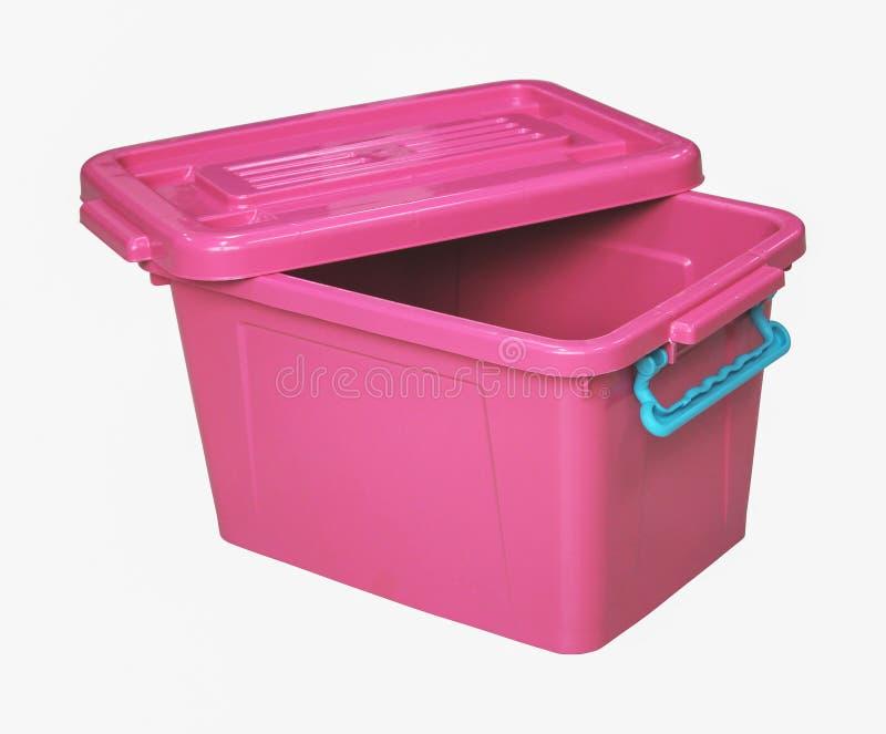 Boîte en plastique rose d'isolement sur le blanc photos libres de droits