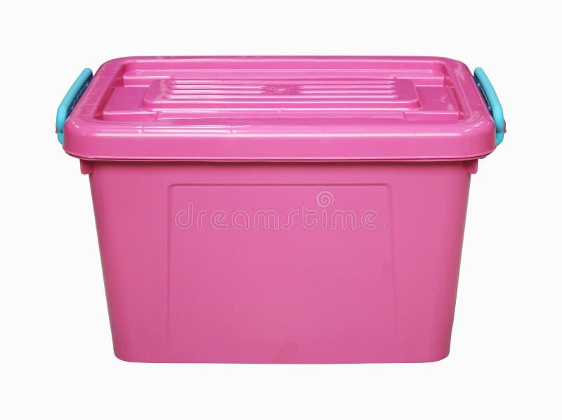 Boîte en plastique rose d'isolement sur le blanc image libre de droits