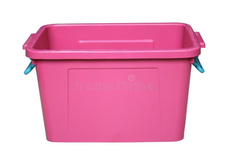 Boîte en plastique rose d'isolement sur le blanc photos stock