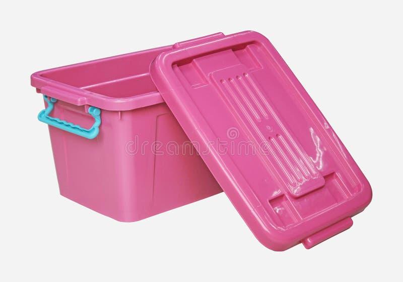 Boîte en plastique rose d'isolement sur le blanc avec le clippingpath images stock