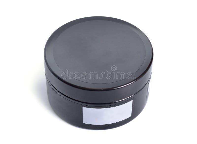 Boîte noire ronde en plastique avec bâton blanc Isolé sur blanc images libres de droits
