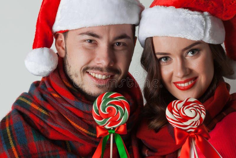 Boże Narodzenie para z lizakami zdjęcia stock