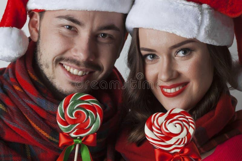 Boże Narodzenie para z lizakami obrazy royalty free