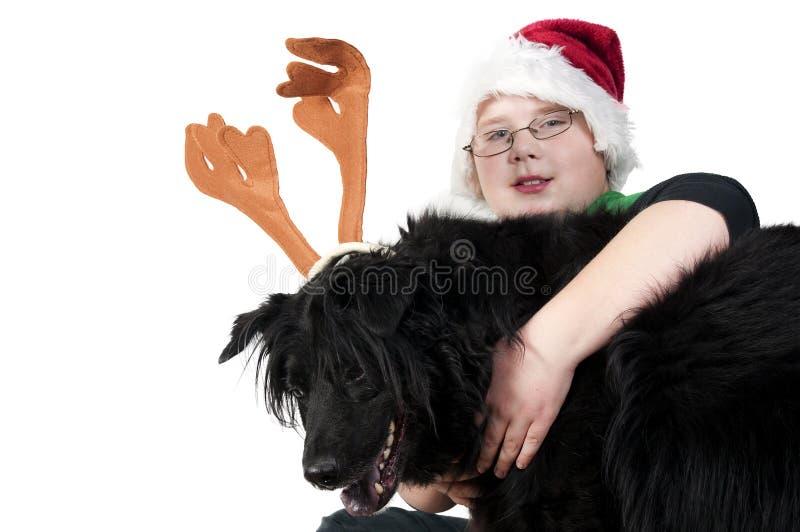 Bożenarodzeniowa chłopiec i jego reniferowy pies obraz royalty free
