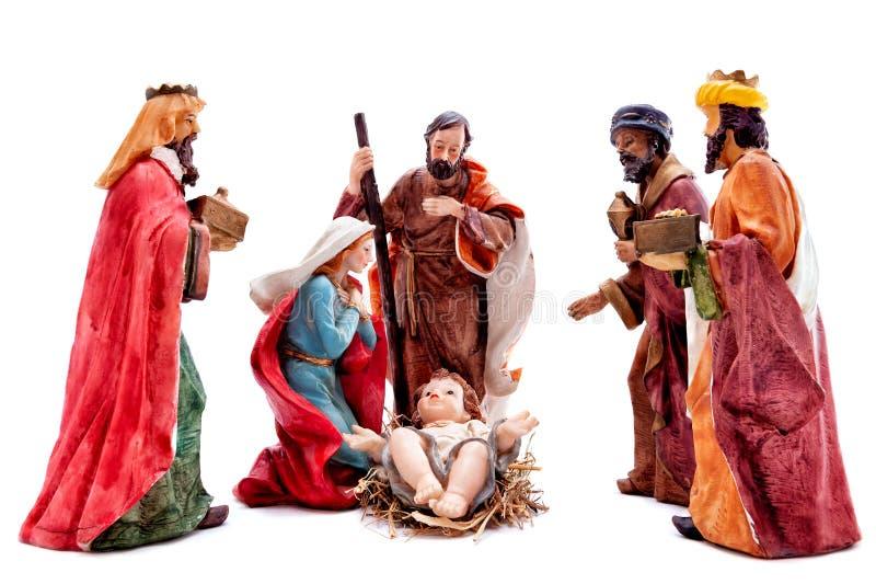 Bożenarodzeniowa narodzenie jezusa scena z Świętą rodziną i trzy mędrzec odizolowywającymi na białym tle, obraz royalty free