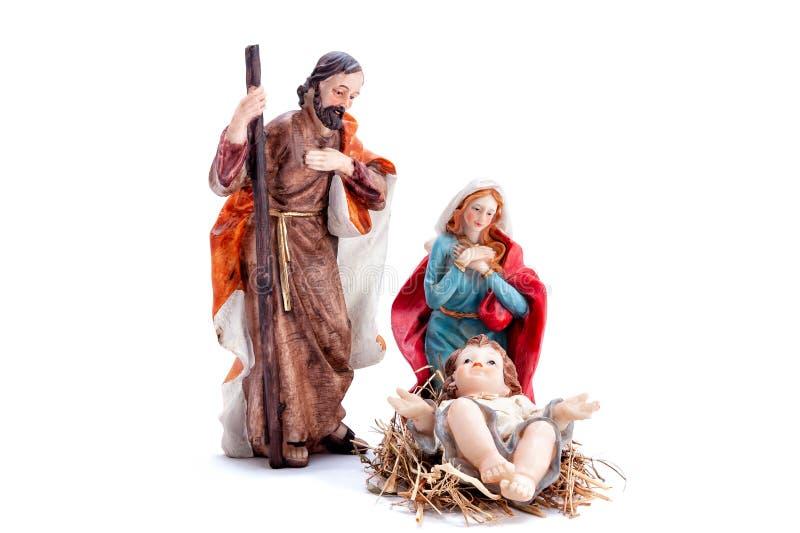 Bożenarodzeniowa narodzenie jezusa scena z Świętą rodziną, odizolowywającą na białym tle zdjęcia royalty free