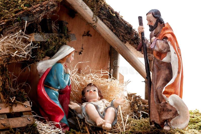 Bożenarodzeniowa narodzenie jezusa scena z Świętą rodziną w budzie, odizolowywającej na białym tle obraz royalty free