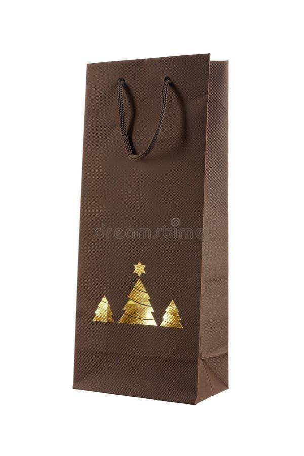 Bożenarodzeniowa prezent torba z złocistymi christams drzewami fotografia stock