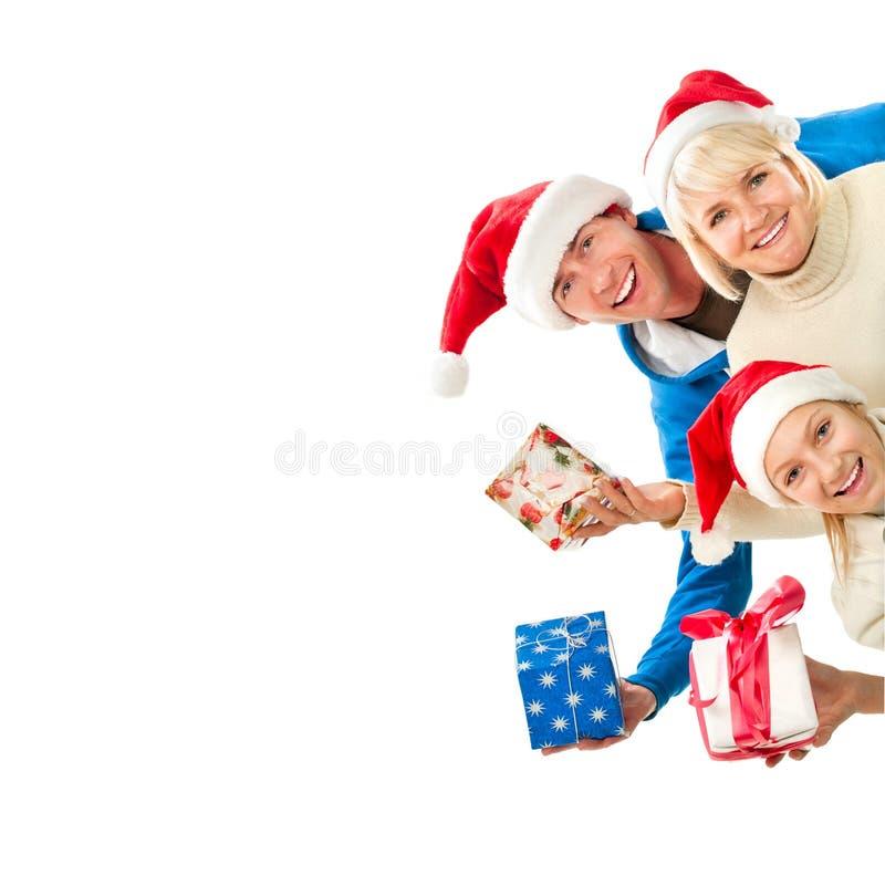Bożenarodzeniowa rodzina z prezentami obraz royalty free