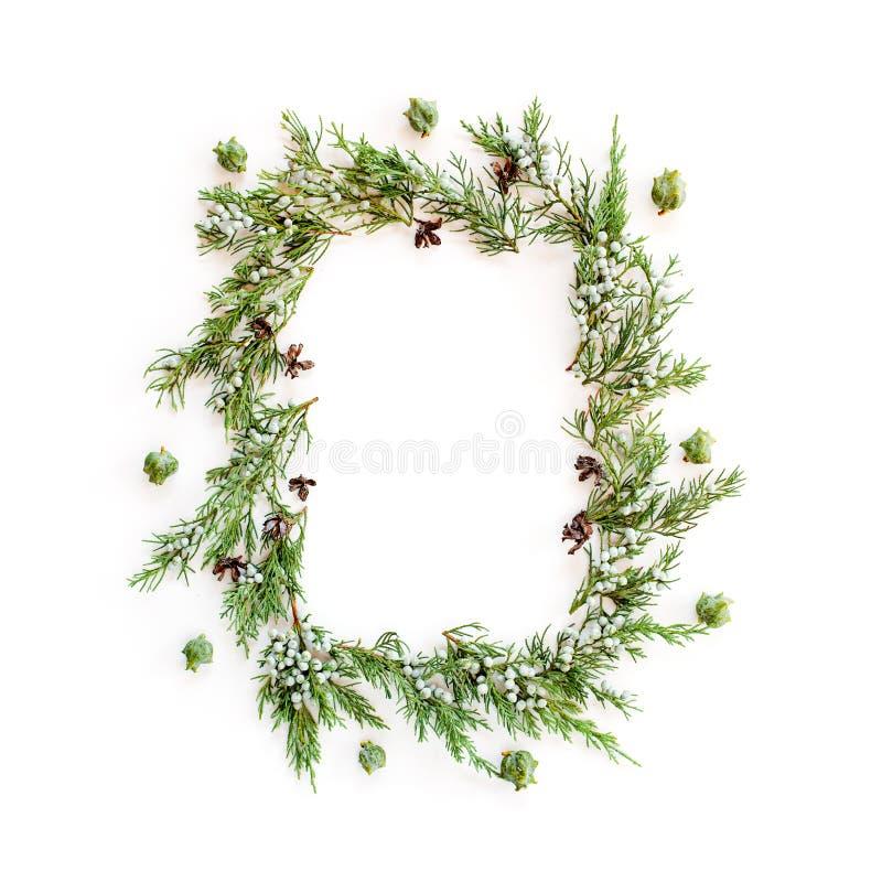Bożenarodzeniowa round rama robić evergreens i rożki zdjęcie royalty free