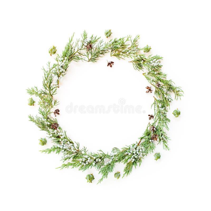 Bożenarodzeniowa round rama robić evergreens i rożki obrazy stock