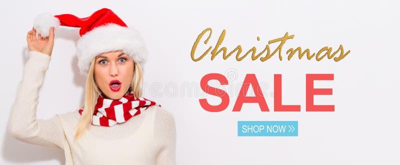 Bożenarodzeniowa sprzedaży wiadomość z kobietą z Santa kapeluszem obrazy stock