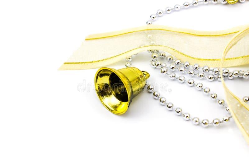 Bożenarodzeniowe złote i srebne dekoracje na białym tle obrazy royalty free