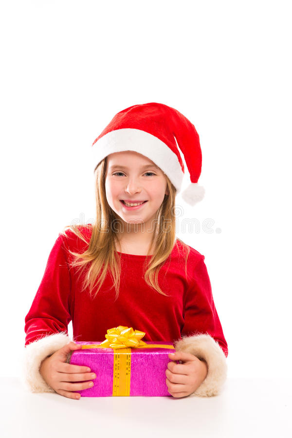Bożenarodzeniowej Santa dzieciaka dziewczyny szczęśliwy z podnieceniem z tasiemkowym prezentem obraz stock
