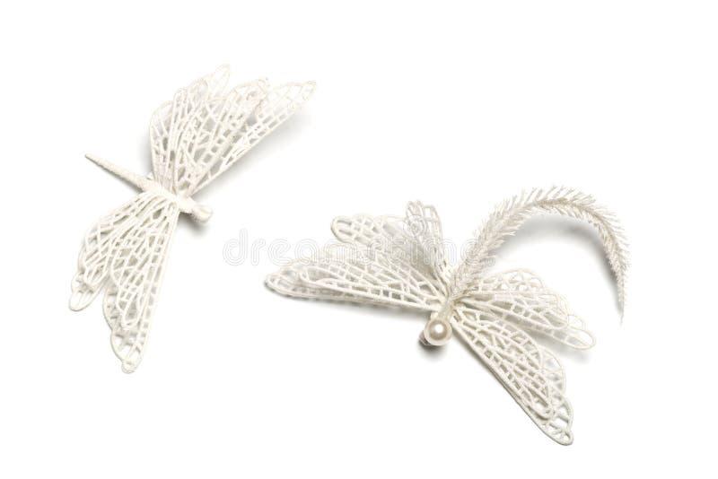 Bożenarodzeniowi dwa dekoracji biali dragonflies na białym odosobnionym tle fotografia stock