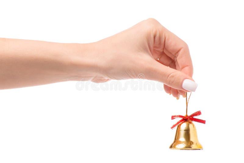Bożenarodzeniowi dzwony w ręce zdjęcia royalty free