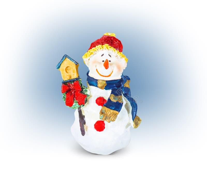 Bożenarodzeniowy śliczny śmieszny uśmiechnięty bałwan z birdhouse, zabawka obrazy stock