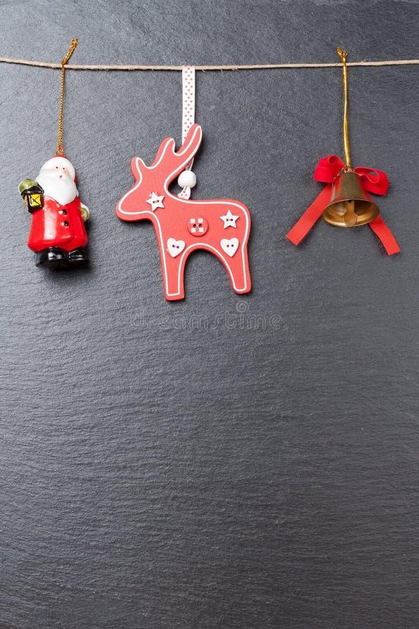 Bożenarodzeniowy dzwon czerwony renifer i Święty Mikołaj, zdjęcie stock