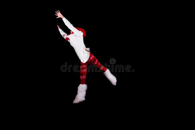 Bożenarodzeniowy elfa akrobata obrazy royalty free