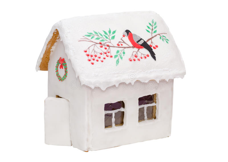 Bożenarodzeniowy piernikowy dom z czerwienią i ptakiem obraz royalty free