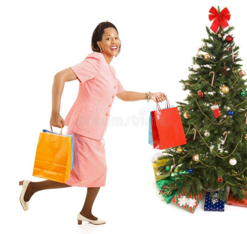 Bożenarodzeniowy zakupy - Biegający dla sprzedaży obraz stock