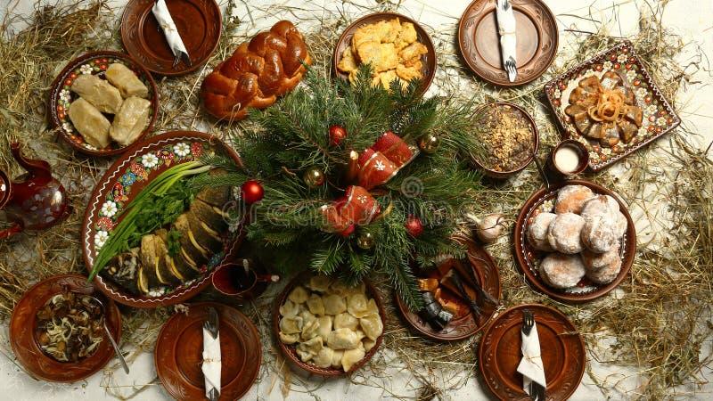 Bo?enarodzeniowy Rodzinny Obiadowego sto?u poj?cie tradycyjny Bożenarodzeniowy słodki posiłek w Ukraina, Białoruś i Polska, na dr zdjęcia stock