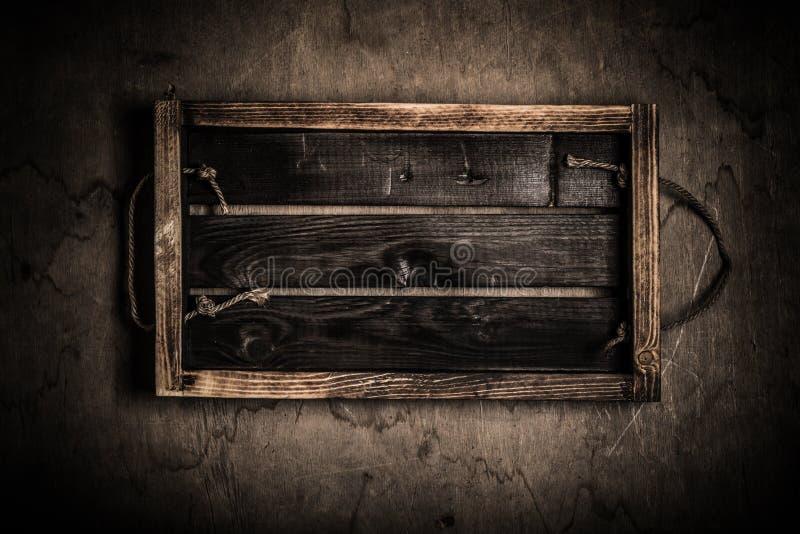 Bo?te br?l?e faite main sur une texture rustique en bois pour le fond Conseil en bois superficiel par les agents approximatif ton photos stock