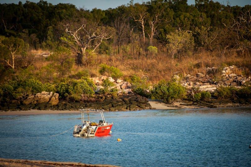 Boab Boat hire boat moored in Honeymoon Bay Kalumburu. Kalumburu, Australia - September 15 2013: Hire boat from Boab Boat Hire moored in Honeymoon Bay in the royalty free stock photo