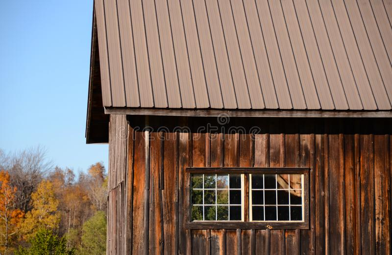 Board and batten vintage antique cedar barn. To preserve barns and buildings in olden days they were constructed with vertical boards to let rain run off flow stock images
