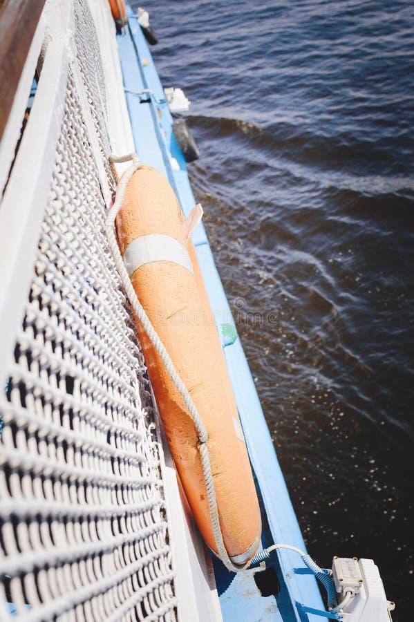 Board the boat, close-up. Lifebuoy. Close-up royalty free stock photography