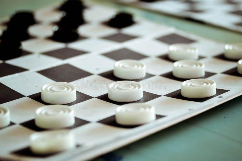 Board with checkers closeup stock photos