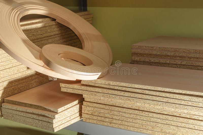 Board chipboard cut parts. For furniture production close-up stock photos