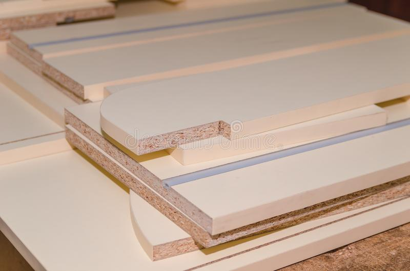 Board chipboard cut parts. For furniture production close-up stock photo